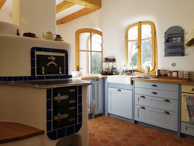 Zkuchyně vede východ naterasu pod pergolou. Pec je navržena tak, aby její zadní část byla funkční součástí kuchyně. Veškeré omítky jsou hliněné azdi mají zaoblené rohy.