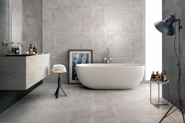 Velmi oblíbený design pohledového betonu se hodí i do historických objektů. Důležitý je dostatek denního světla, aby nepůsobil ponuře (na fotografii keramický obklad Supergres Graphite Cement, design ve stylu vintage dodává zajímavou patinu