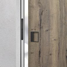 Dveře MASONITE v dřevodekoru dub Halifax tabákový s kováním Magnetic v černém matném niklu. Magnetické kování funguje bez kliky a především bez závad (MASONITE)